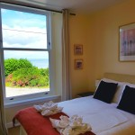 Double bedroom with large wardrobes and spectacular sea views