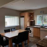Dining kitchen with fridge freezer, microwave, kettle, toaster and coffee maker