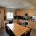 Fully equipped kitchen with integrated oven, ceramic hob, dishwasher and washing maching