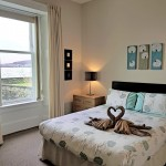 Spacious master bedroom with sea views and king size bed