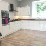 Spacious kitchen fitted with electric oven, ceramic hob, fridge freezer, dishwasher and washing machine