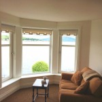 Comfortable seating in master bedroom with wonderful sea views
