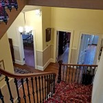 Winding staircase with shallow steps leading to the upstairs bedrooms